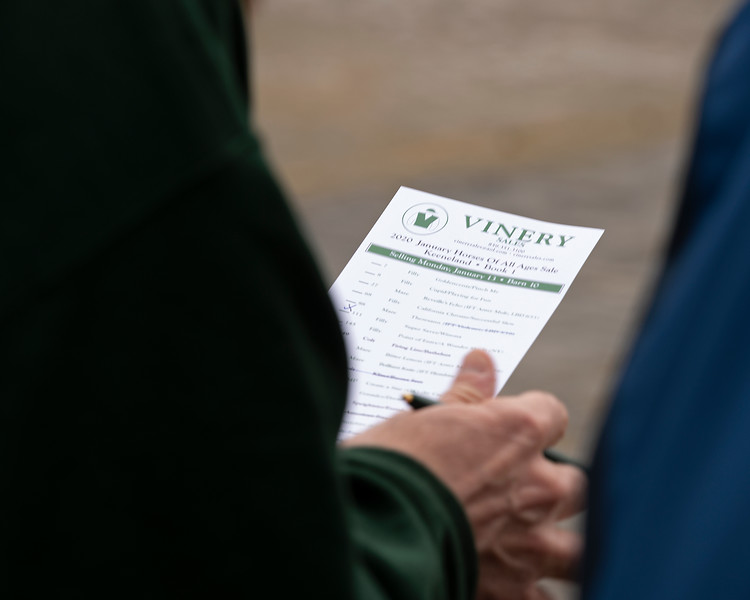 Vinery. Derek MacKenzie with Vinery on left reviews card with buyer. Scenes during the Keeneland January sales on Jan. 11, 2020 Keeneland in Lexington, KY.