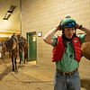 Caption: Destin puts on his vest and helmet before mountin his other pony, Fred, left.<br /> A native of Oklahoma, Heath started working at WinStar Farm on October 10, 2014, and became the farm trainer in October of 2018. Presently he has about 100 horses in training at the WinStar Farm training center, where they have a 7 1/2-furlong main track and 3/4 of a mile undulating turf gallop.<br /> Daily Life series on Destin Heath, farm trainer at WinStar Farm on Aug. 11, 2020 WinStar Farm in Versailles, KY.