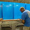 Caption: final production of Covid-19 shields for businesses before being placed in van for transport<br /> Tim and Anna Cambron at Ruggles sign company in Versailles, Ky. on July 8, 2020 Ruggles in Versailles, KY.