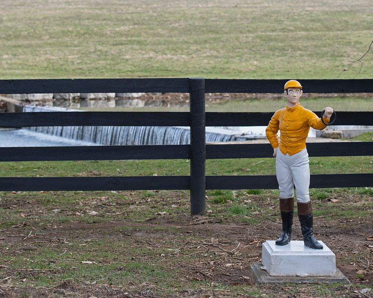 Claiborne scene, jockey statue in farm colors in front of waterfall outside office. Preach at Claiborne Farm In Paris, Ky., on March 20, 2019.