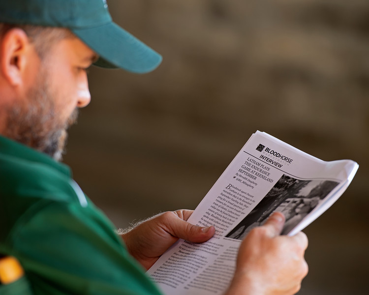 Reading the BloodHorse Daily<br /> at the Keeneland September Sale.
