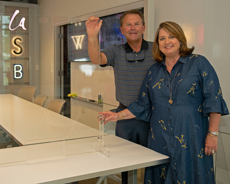 Caption:  (L-R): Tim and Anna Cambron with shields being produced by Ruggles during Covid-19<br /> Tim and Anna Cambron at Ruggles sign company in Versailles, Ky. on July 8, 2020 Ruggles in Versailles, KY.