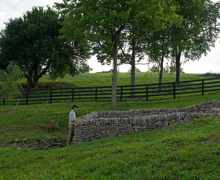 Caption:  Aidan O'Meara looking over updated construction around natural springs.<br /> Aidan and Leah O'Meara at Stonehaven Steadings near Versailles, Ky. on Aug. 7, 2020 Stonehaven Steadings in Versailles, KY.