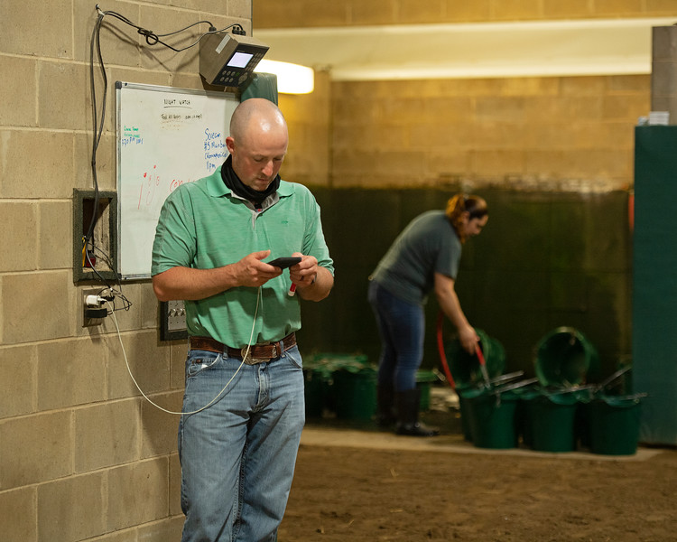 Caption:  about 4:30 am, charging his phone and checking his phone when alerted to a text.<br /> A native of Oklahoma, Heath started working at WinStar Farm on October 10, 2014, and became the farm trainer in October of 2018. Presently he has about 100 horses in training at the WinStar Farm training center, where they have a 7 1/2-furlong main track and 3/4 of a mile undulating turf gallop.<br /> Daily Life series on Destin Heath, farm trainer at WinStar Farm on Aug. 11, 2020 WinStar Farm in Versailles, KY.