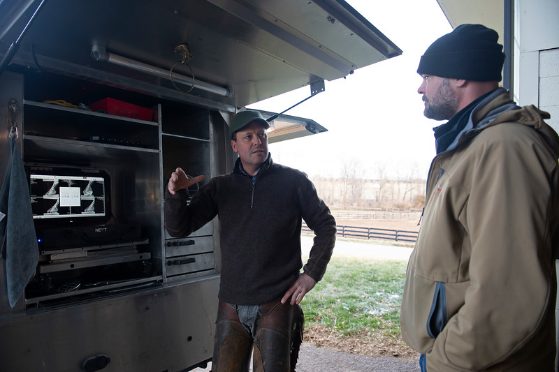 (L-R):  Scott Morrison DVM and Guiness McFadden discuss progress regarding Country House with radiograph xrays on screen at Blackwood Stables on<br /> Feb. 28, 2020 Blackwood Stables in Versailles, KY.