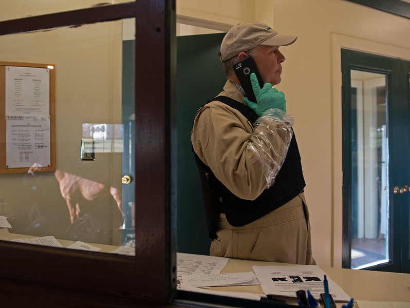 Caption: About 9:50 am, Billy talks with vet Dr. Joseph Kamper from Hagyard and calls Lane's End office to discuss the upcoming mare, shown on left. Daily Life on Billy Sellers, Lane's End Farm stallion manager who started working for the farm in 1982 and who has been their only stallion manager since 1985 when the farm acquired their first stallions, photographed on<br /> March 3, 2020 Lane's End Farm in Versailles, KY.