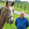 Caption: Searing looking over a yearling<br /> Lee and Susan Searing look over their bloodstock (mares, foals, yearlings) at Springhouse Farm near Nicholasville, Ky., on June 22, 2020 Springhouse Farm in Nicholasville, KY.