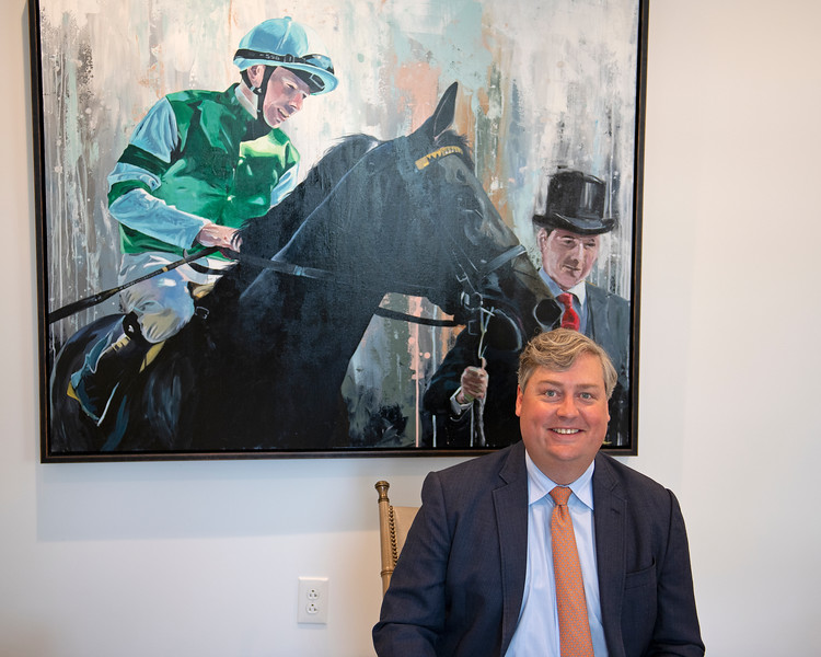 Caption: in front of his Con Te Partiro painting.  Drew had interest in horse.<br /> Breeders' Cup CEO and President Drew Fleming in the Breeders' Cup office in downtown Lexington, Ky., on June 16, 2020 Drew Fleming in Lexington, KY.