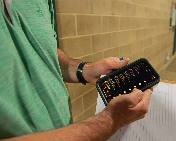 Caption: Destin holds his phone that shows all of his daily early morning alarms he sets to make sure he wakes up. <br /> A native of Oklahoma, Heath started working at WinStar Farm on October 10, 2014, and became the farm trainer in October of 2018. Presently he has about 100 horses in training at the WinStar Farm training center, where they have a 7 1/2-furlong main track and 3/4 of a mile undulating turf gallop.<br /> Daily Life series on Destin Heath, farm trainer at WinStar Farm on Aug. 11, 2020 WinStar Farm in Versailles, KY.