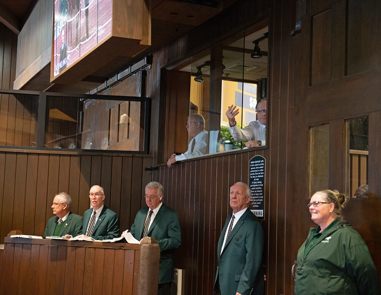 (L-R): front row, Charles Goggin, Mark Plummer, Jeff Fritsch, and Chris Stanifer, top, Stan Deupree, and Jeff Stansberry (fingers up taking bid). Back ring auction crew with Jeff Stansberry taking bid (top right) on Jan. 16, 2020 Keeneland in Lexington, KY.