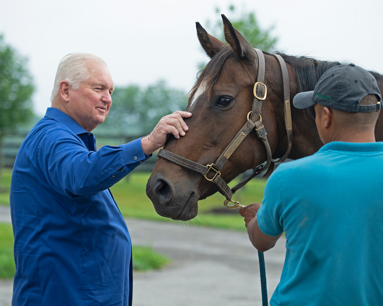 Caption: Searing petting Economy of Motion<br /> Lee and Susan Searing look over their bloodstock (mares, foals, yearlings) at Springhouse Farm near Nicholasville, Ky., on June 22, 2020 Springhouse Farm in Nicholasville, KY.