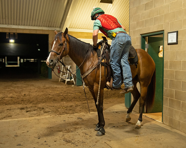Caption: Destin mounts his other pony, Fred,.<br /> A native of Oklahoma, Heath started working at WinStar Farm on October 10, 2014, and became the farm trainer in October of 2018. Presently he has about 100 horses in training at the WinStar Farm training center, where they have a 7 1/2-furlong main track and 3/4 of a mile undulating turf gallop.<br /> Daily Life series on Destin Heath, farm trainer at WinStar Farm on Aug. 11, 2020 WinStar Farm in Versailles, KY.