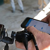 Keith Latson DVM inputting data on his Apollo app after doing a video endoscopic exam at the Keeneland September Sale.