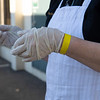 Caption: Phyllis Keene, track kitchen manager, waits to receive Sysco food delivery in safetly gloves and yellow wristband, from Keeneland screening upon entering the track that day<br /> Behind the Scenes at Keeneland during Covid19 virus and the people, horses, and essentials needed to take care of race horses on April 2, 2020 Keeneland in Lexington, KY.