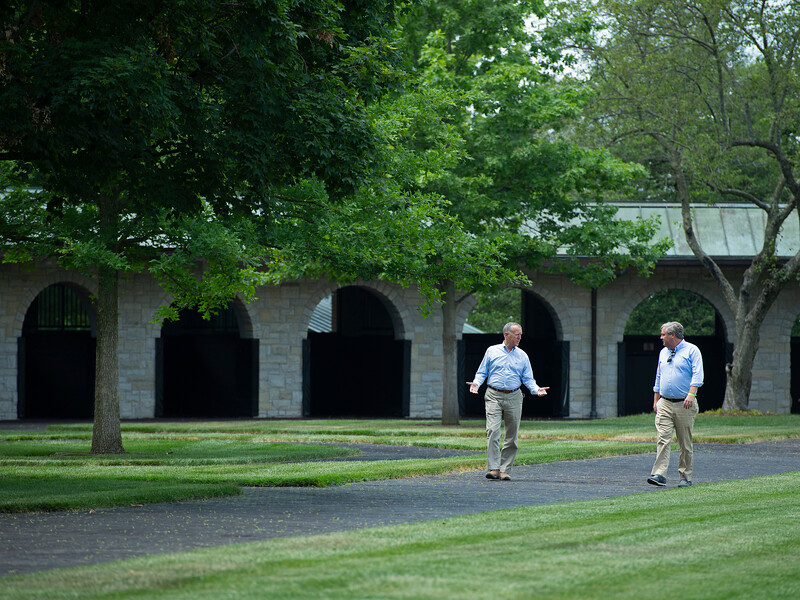 Caption:(L-R): Thomason and Fleming  talking and walking in the saddling area<br /> Drew Fleming with Bill Thomason at Keeneland in Lexington, Ky., on June 19, 2020 Keeneland in Lexington, KY.