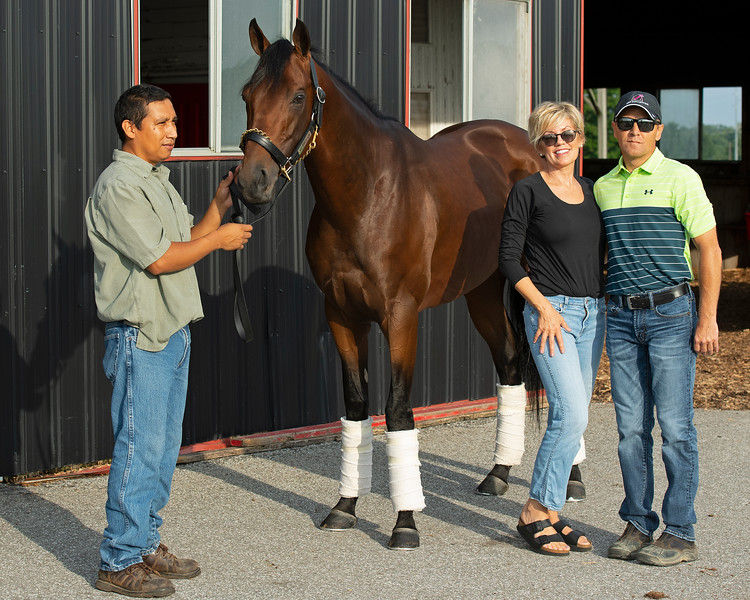 Caption: Art Collector with barn foreman Jose Garcia and Eleanor Porco and Tommy Drury. <br /> Bruce Lunsford at Skylight Training Center with his horse Art Collector and trainer Tommy Drury on Aug. 12, 2020 Skylight Training Center in Prospect, KY.