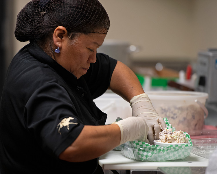 """Caption: Maria Costobel manages the assembly of the """"to-go"""" food orders and stock. <br /> Behind the Scenes at Keeneland during Covid19 virus and the people, horses, and essentials needed to take care of race horses on April 2, 2020 Keeneland in Lexington, KY."""