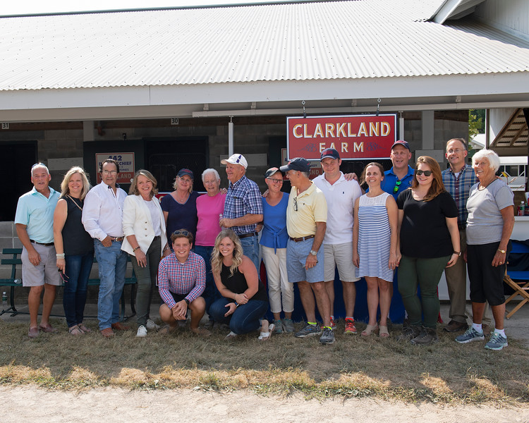Clarkland team<br /> at the Keeneland September Sale. Fred and Nancy (pink shirt) Mitchell, with daughter Marty Buckner (next to Fred, blue shirt) and son-in-law Matt (Ernie) Ernst.