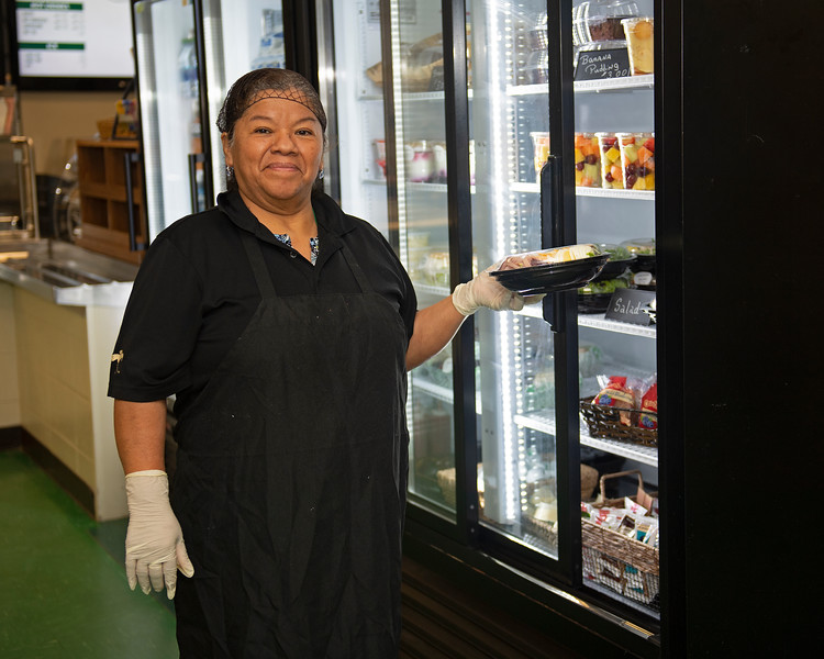 """Caption: Maria Costobel manages the assembly of the """"to-go"""" food orders and stocks the refridgerated section of the kitchen<br /> Behind the Scenes at Keeneland during Covid19 virus and the people, horses, and essentials needed to take care of race horses on April 2, 2020 Keeneland in Lexington, KY."""