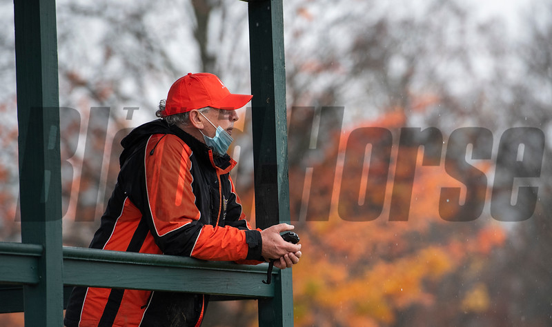 Trainer Phil Gleaves, with stopwatch in hand prepares for the breeze of his charge Second of July at the Oklahoma Training Center Wednesday Oct. 28, 2020 in Saratoga Springs< N.Y.   Photo by Skip Dickstein