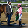 Jockey Manny Franco speaks with trainer George Weaver after a race at the Saratoga Race Track July 2020. Photo by Skip Dickstein