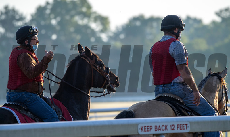 NYRA Outriders using masks and following Safety Protocols keep an eye on the Oklahoma Training Center track as it opens for the first time this season Thursday June 4, 2020 in Saratoga Springs, N.Y.  Photo by Skip Dickstein