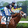 Drain the Clock with jockey Jose Ortiz aboard wins the 37th running of The Woody Stephens on Belmont Stakes Day at Belmont Park Saturday June 5, 2021 in Elmont, N.Y.  . Photo  by Skip Dickstein