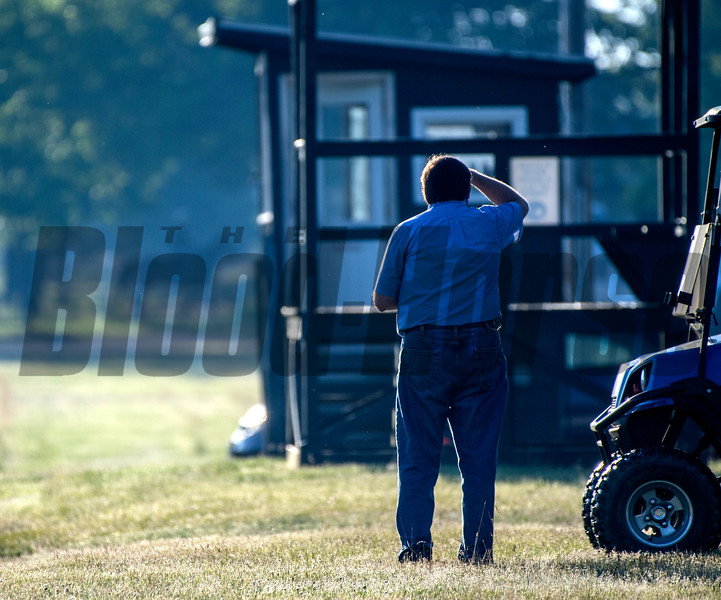 Trainer H. James Bond watches as one of charges leaves  the Oklahoma Training Center track as it opens for the first time this season Thursday June 4, 2020 in Saratoga Springs, N.Y.  Photo by Skip Dickstein
