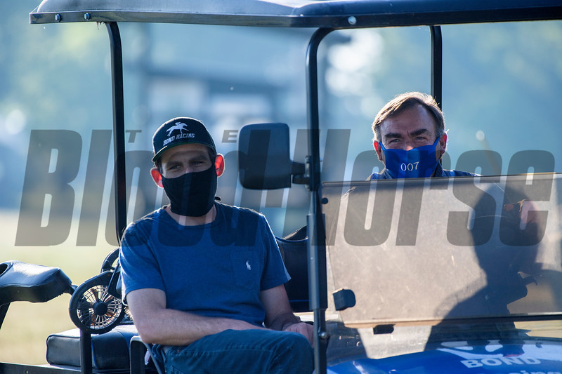 Assistant trainer Ryan Bond, left sits with father H. James Bond as they watch their charges take to the Oklahoma Training Center track as it opens for the first time this season Thursday June 4, 2020 in Saratoga Springs, N.Y.  Photo by Skip Dickstein