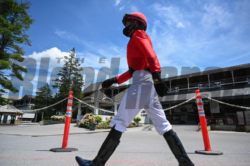 Jockey Manny Franco walks to the jockeys room after a race at the Saratoga Race Track July 2020.  Photo by Skip Dickstein