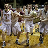 PORTLAND, MAINE -- 2/27/15 -- The Cape Elizabeth boys basketball team rushes off the court with the gold ball after defeating Medomak Valley High School 44-42 in the Class B State Championship game at Cross Insurance Arena in Portland Friday night. Troy R. Bennett | BDN