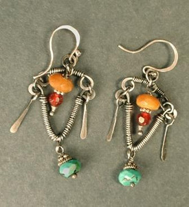 Silver and turquoise earrings by Jody Wilke. Shot on black paper with three photofloods.