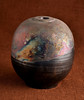 Raku pottery by Bob Arnold. One 500 W photoflood to right through translucent plastic and white reflector board on left.