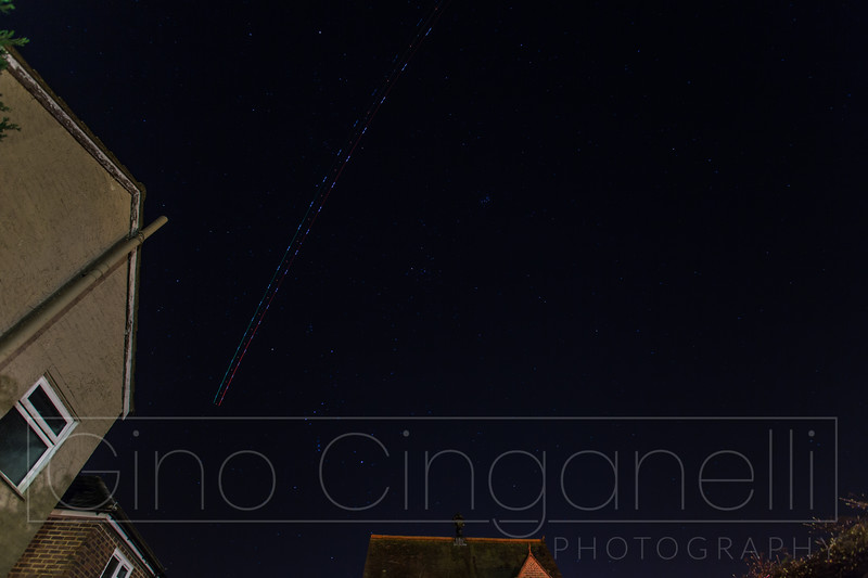 A plane on a slow shutter in the night sky