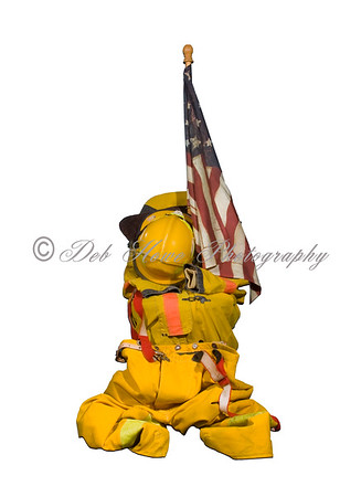 Fire suit with helmet and american flag on white