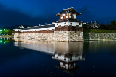 Taikoyagura drum turret over looking the moat at night time.
