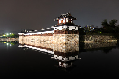 Taikoyagura, drum turret and its reflection in the moat. Night time.