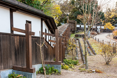 Dobei walls, basically a mud, clay and Japanese grass mix plaster with wooden supports and a tiled roof. Shooting holes were then placed with their shape depending on the type of weapon used.