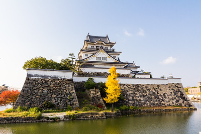 The tenshu, keep, with dobei and ishigaki stone walls and moat.