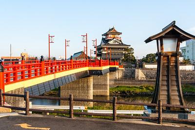 The vermillion bridge leading to the castle.