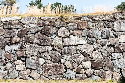 Ishigaki stone walls, interlocking stones, some with stone mason's marks on.
