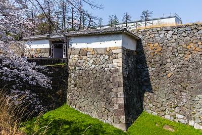 The omote-ninomon gate. An older style Koraimon wooden gate way through ishigaki, stone wall.