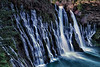 Burney Falls. The rock is so porous that the water from Burney Creek flows through the rock.
