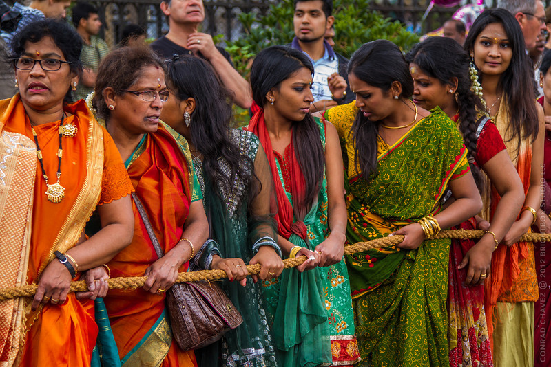 Women prepare to pull their chariot that carries an idol of Lord Ganesh.