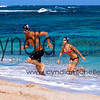 Competitive Swimmer Kale Ai and Rebecca Walton swimming on Oahu's North Shore, March 29, 2013