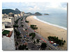 Copacabana Beach is a long and relatively wide stretch of sand, the backdrop to the beach formed by a line of hotels and restaurants. Left view of Copacabana beach taken from Marriot hotel, Brazil.