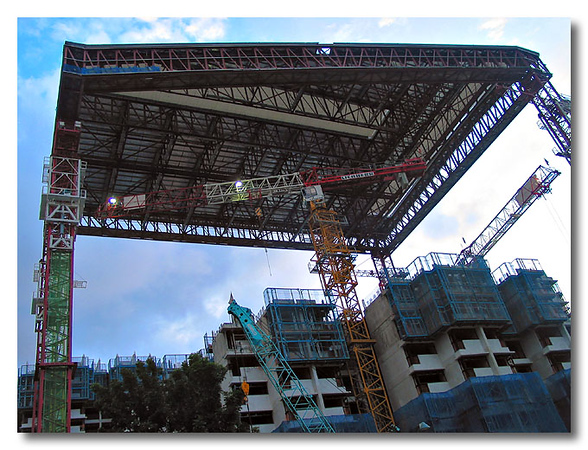 A roof over the construction of a 40 storey block in Toa Payoh.