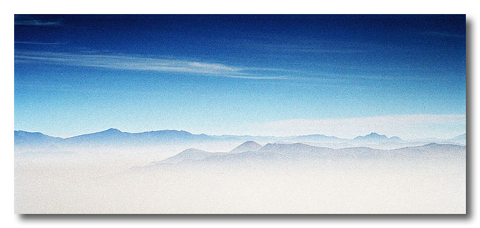 The Andes mountain range. Nope, those are not clouds, they are smog!! Santiago, Chile.
