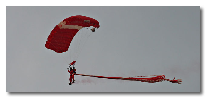 Skydivers in flight. National Day Parade 2003.