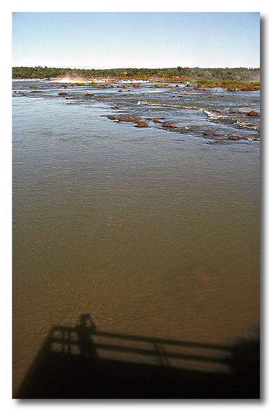 The calm waters before the falls. Yeah, that's my shadow...Iguaçu Falls, Brazil.